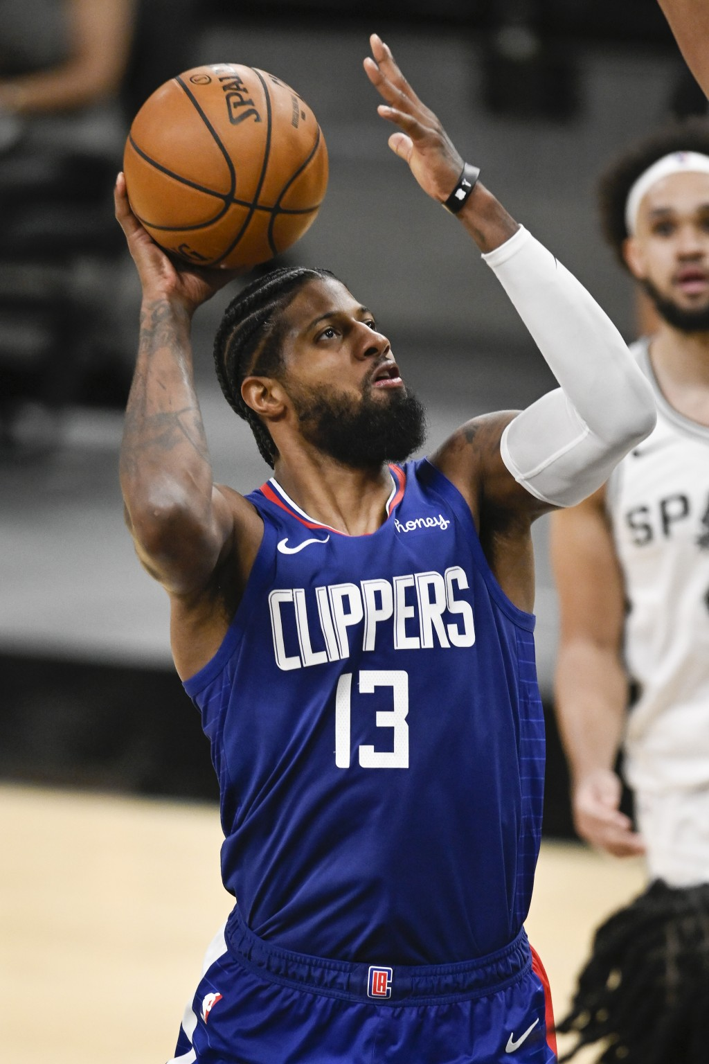 Los Angeles Clippers' Paul George shoots during the second half of an NBA basketball game against the San Antonio Spurs on Wednesday, March 24, 2021, ...