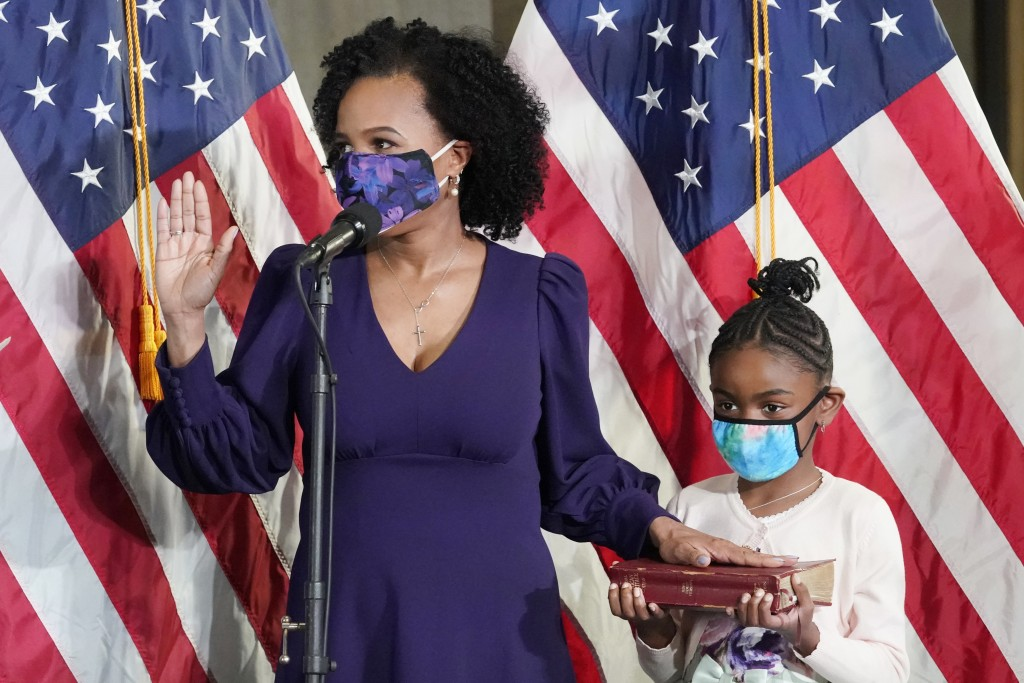 Former Boston City Council President Kim Janey, 55, is sworn in as Boston's new mayor at City Hall while her granddaughter, Rosie, holds a Bible, Wedn...