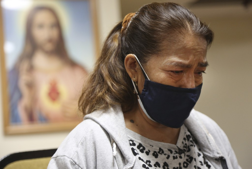 Rosa Fernández cries as she talks about losing her son to COVID-19 on Friday, March 5, 2021, in the basement chapel of Our lady of Sorrows Roman Catho...