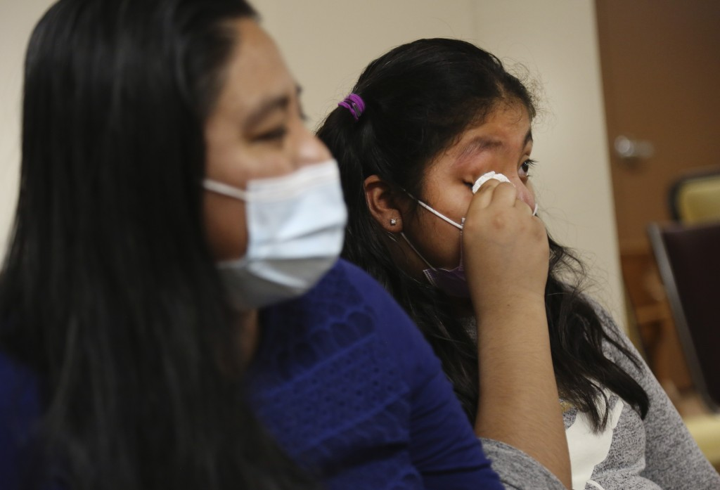 Stephany Martinez wipes tears from her eyes as she talks about losing her grandparents to the coronavirus, while sitting next to her mother, Reyna Mar...