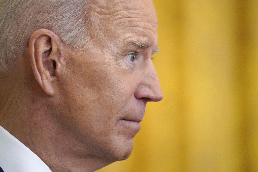 President Joe Biden listens to a question during a news conference in the East Room of the White House, Thursday, March 25, 2021, in Washington. (AP P...