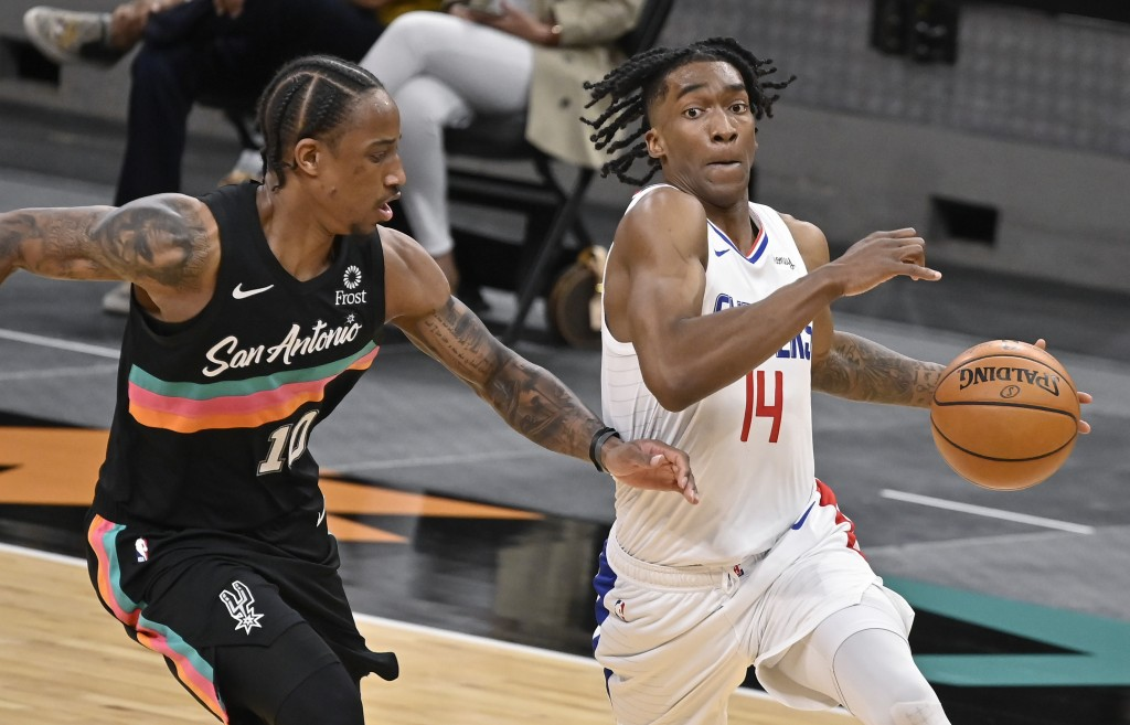 Los Angeles Clippers' Terance Mann (14) drives around San Antonio Spurs' DeMar DeRozan during the second half of an NBA basketball game on Thursday, M...