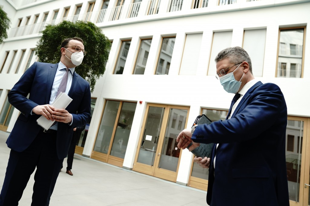 Jens Spahn, Federal Minister of Health, left, and Lothar Wieler, President of the Robert Koch Institute, arrive for the press conference on the Corona...