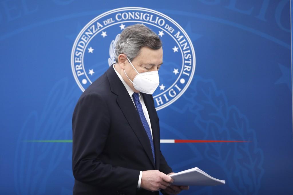 Italian Prime Minister Mario Draghi meets the press, in Rome, Friday, March 26, 2021. (AP Photo/Alessandra Tarantino, pool)