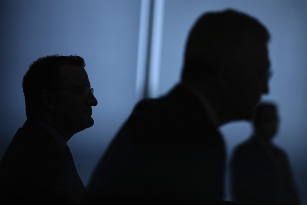 Germany's Health Minister Jens Spahn, left, and Lothar Wieler, the head of Germany's Robert Koch Institute (RKI) for disease control attend a news con...
