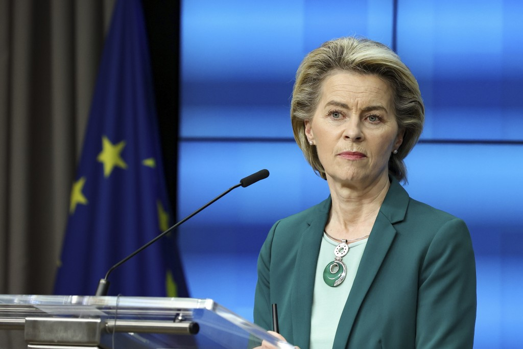 European Commission President Ursula von der Leyen listens to a question during an online news conference at the end of a EU summit at the European Co...