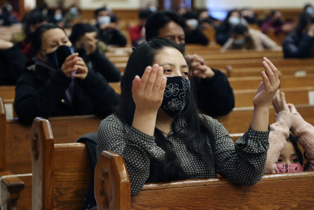 Parishioners pray during Mass at Our Lady of Sorrows in the Queens borough of New York on Sunday, March 7, 2021. The Roman Catholic church reopened fo...