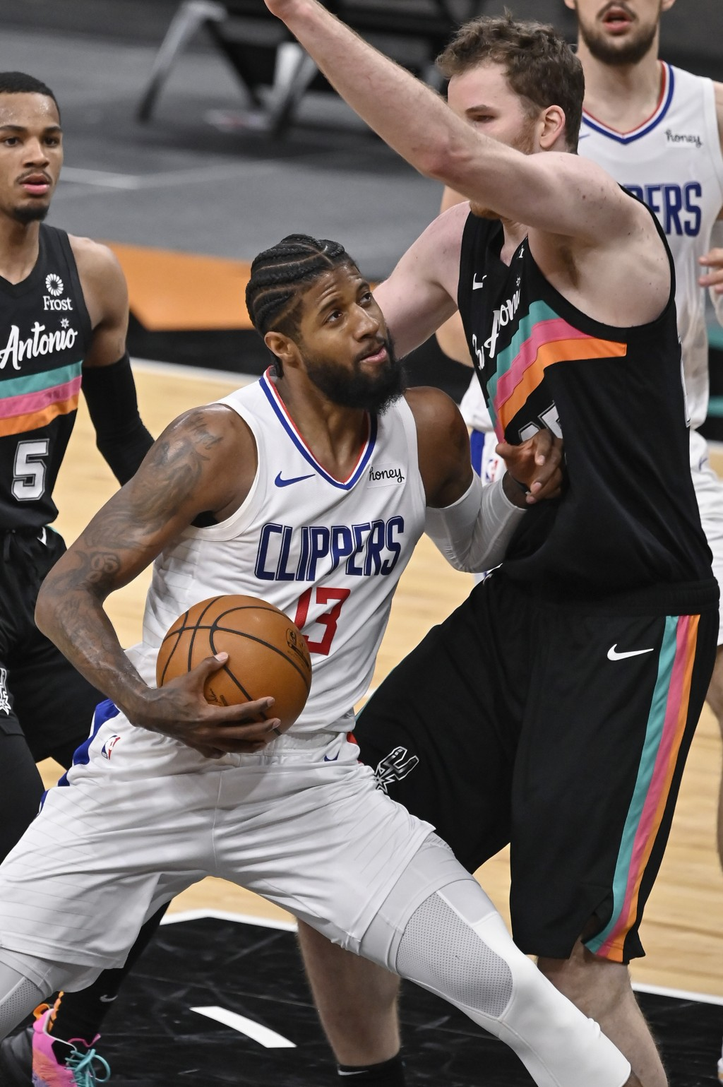 Los Angeles Clippers' Paul George (13) attempts to shoot against San Antonio Spurs' Jakob Poeltl during the second half of an NBA basketball game on T...