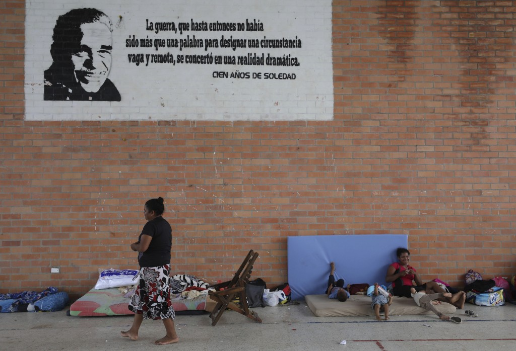 Venezuelans rest at a community center being used as a shelter in Arauquita, Colombia, Thursday, March 25, 2021, on the border with Venezuela. Thousan...