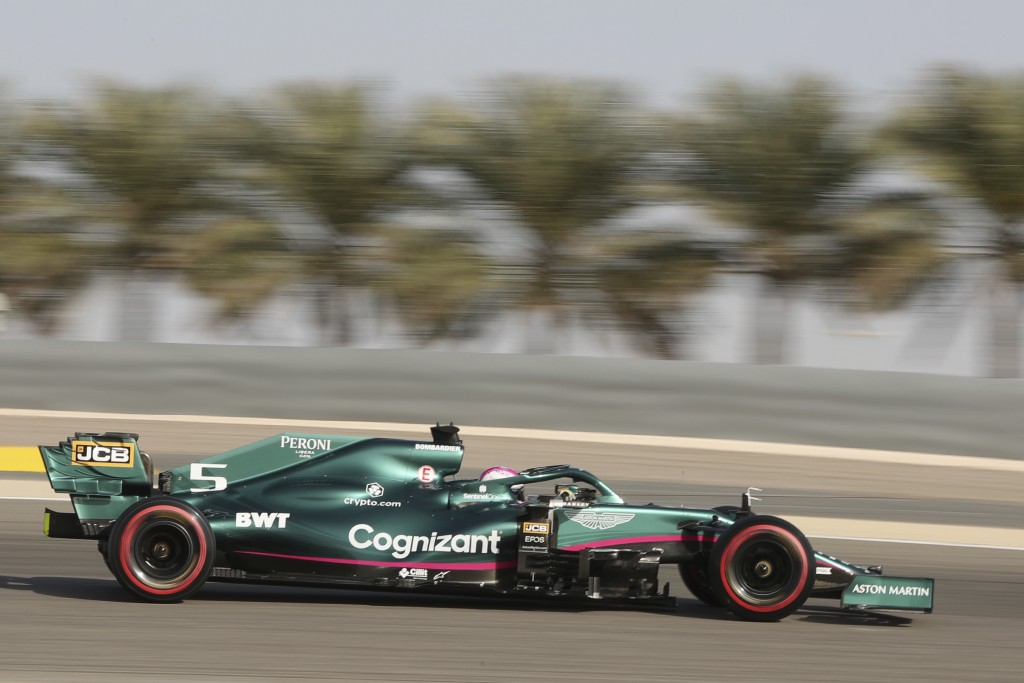 Aston Martin driver Sebastian Vettel of Germany steers his car during the third free practice at the Formula One Bahrain International Circuit in Sakh...