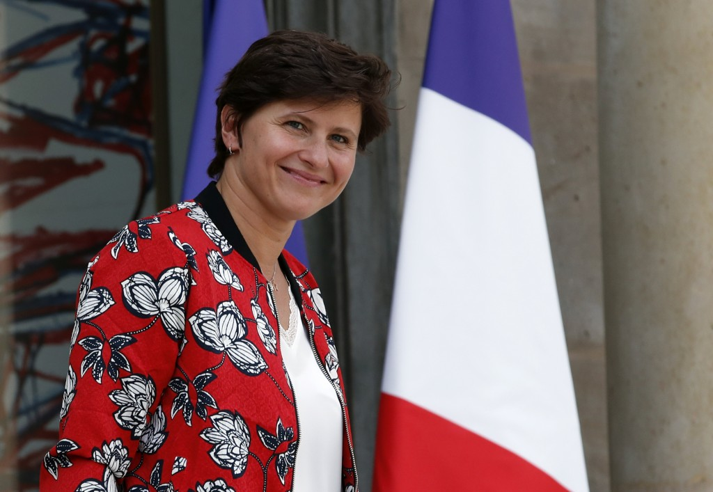 French Sports Minister Roxana Maracineanu leaves the Elysee Palace after the weekly cabinet meeting, in Paris, Wednesday, Sept. 5, 2018. France's spor...