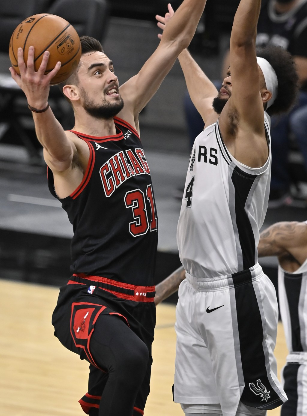 Chicago Bulls' Tomas Satoransky (31) shoots against San Antonio Spurs' Derrick White during the first half of an NBA basketball game on Saturday, Marc...