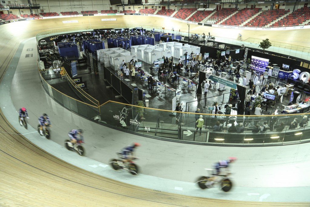 Riders train at the National Velodrome at Saint-Quentin-en-Yvelines, west of Paris, Saturday, March 27, 2021, that has been transformed into a mass va...