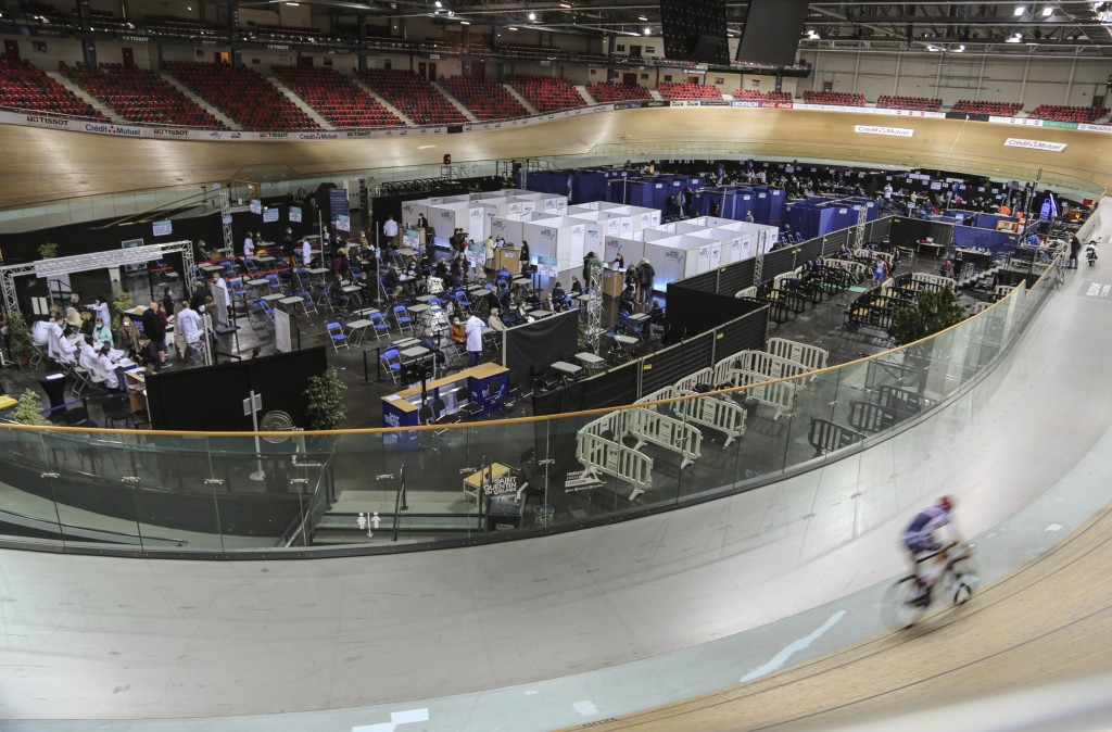 A riders trains at the National Velodrome at Saint-Quentin-en-Yvelines, west of Paris, Saturday, March 27, 2021, that has been transformed into a mass...