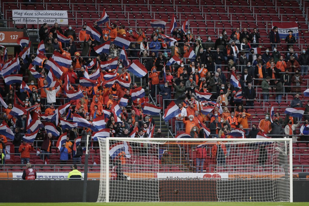 Spectators watch during the World Cup 2022 group G qualifying soccer match between The Netherlands and Latvia at the Johan Cruyff ArenA in Amsterdam, ...