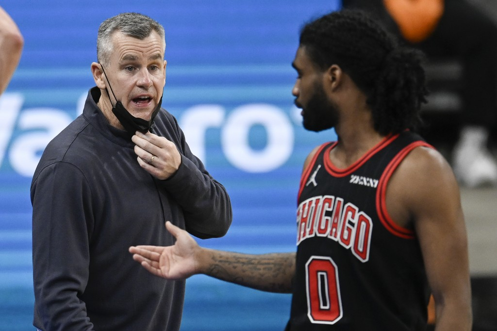 Chicago Bulls head coach Billy Donovan, left, talks to Bulls guard Coby White during the second half of an NBA basketball game against the San Antonio...