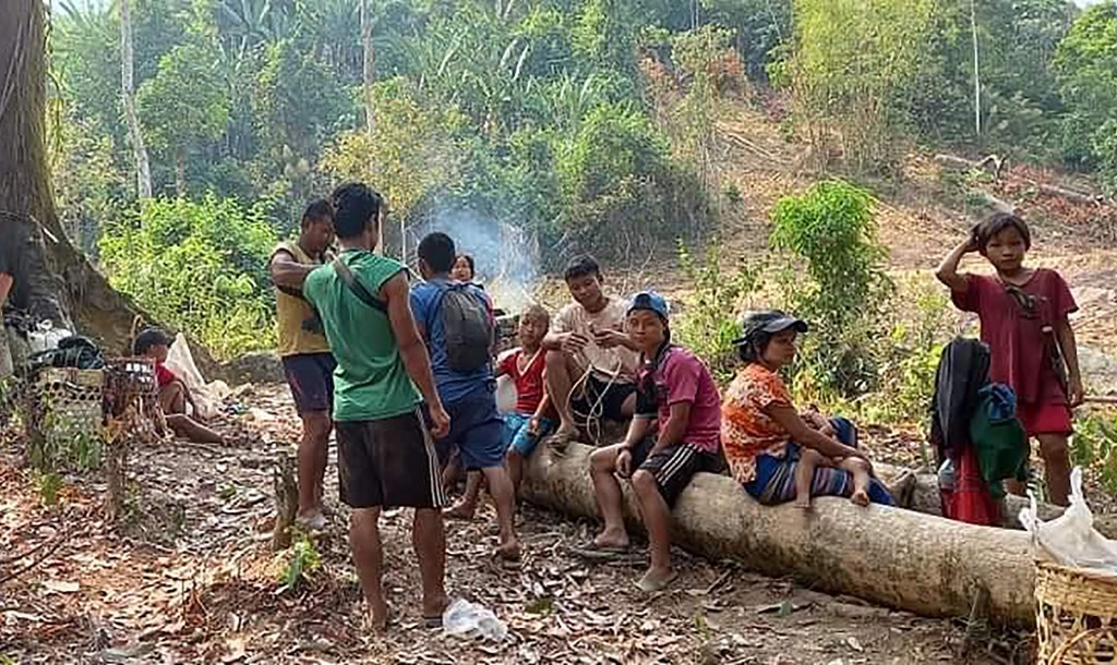 In this photo released by the Free Burma Rangers, Karen villagers gather in the forests as they hide from military airstrikes in the Deh Bu Noh area o...