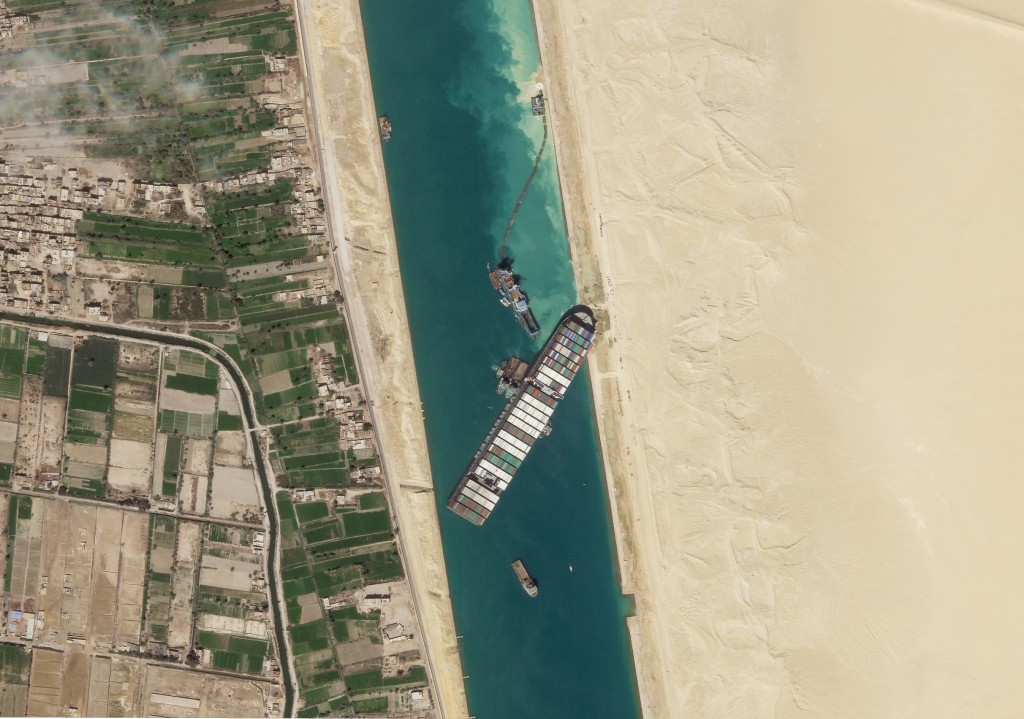FILE - In this March 28, 2021, satellite file image from Planet Labs Inc, the cargo ship MV Ever Given sits stuck in the Suez Canal near Suez, Egypt. ...