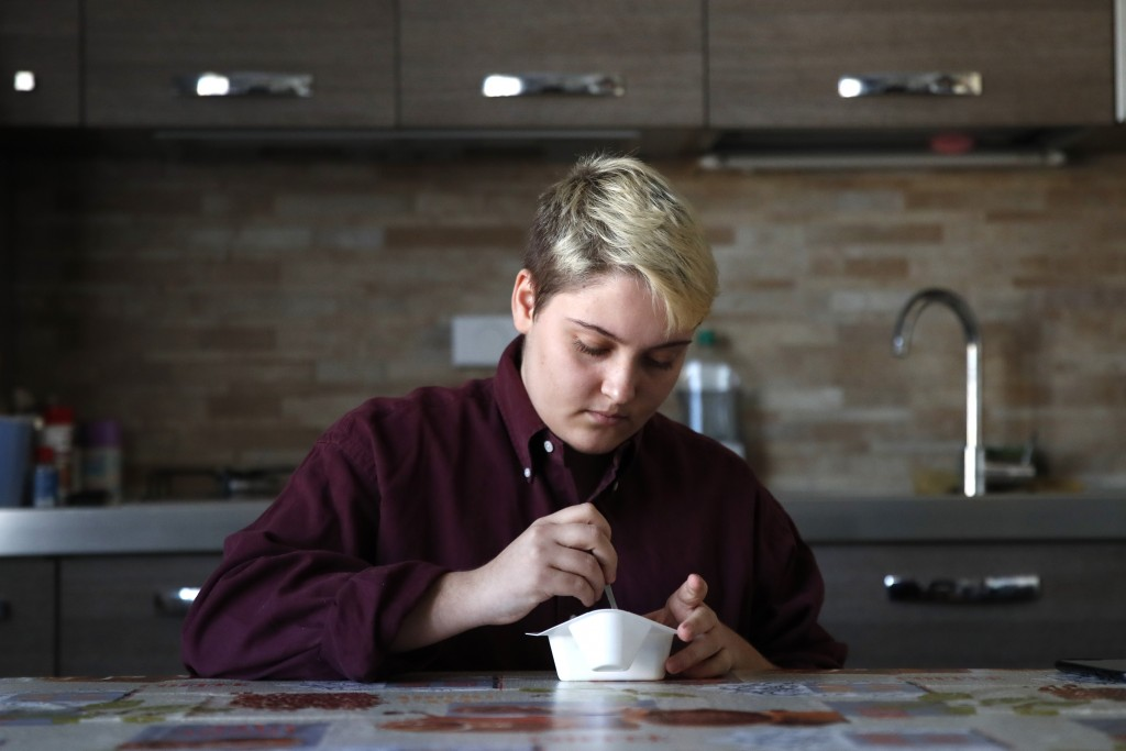 Matteo Coccimiglio eats his breakfast in Rome, Thursday, March 18, 2021. Matteo is an 18-year-old student who identifies as a man and is in the proces...