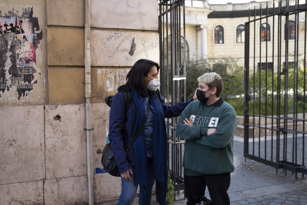 Matteo Coccimiglio talks with Sonia Mugello, a teacher at the Ripetta art Schools in Rome, Wednesday, March 24, 2021. Matteo is an 18-year-old student...