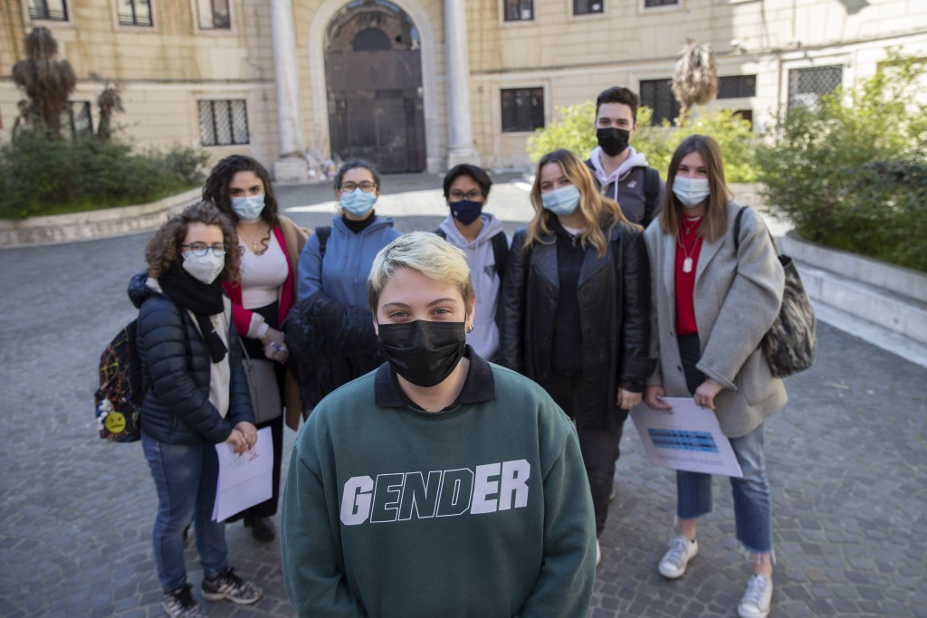 Matteo Coccimiglio poses for a photos with his schoolmates in front of the Ripetta art school in Rome, Wednesday, March 24, 2021. Matteo is an 18-year...