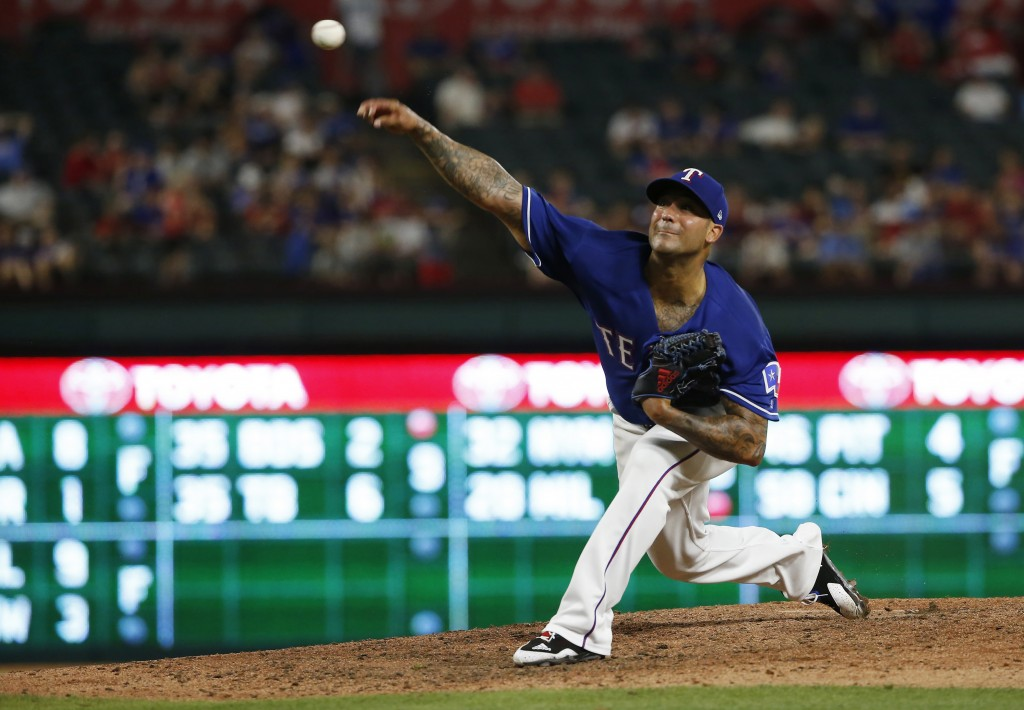 FILE - In this May 24, 2018 file photo, Texas Rangers relief pitcher Matt Bush delivers against the Kansas City Royals during the seventh inning of a ...