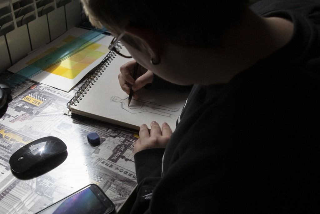 Matteo draws in his room in Rome, Saturday, March 20, 2021. Matteo Coccimiglio is an 18-year-old student who identifies as a man and is in the process...