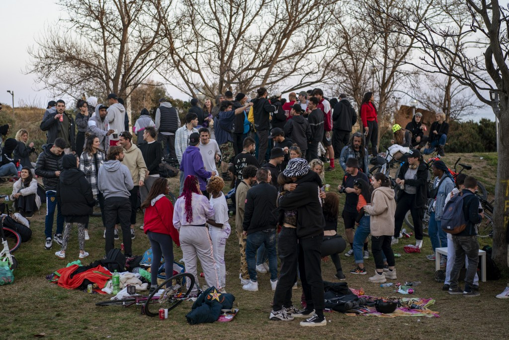 Local people gather at a public park in Barcelona, Spain, Sunday, March 28, 2021. Efforts in Spain to restart tourism activity is drawing a mixed pict...
