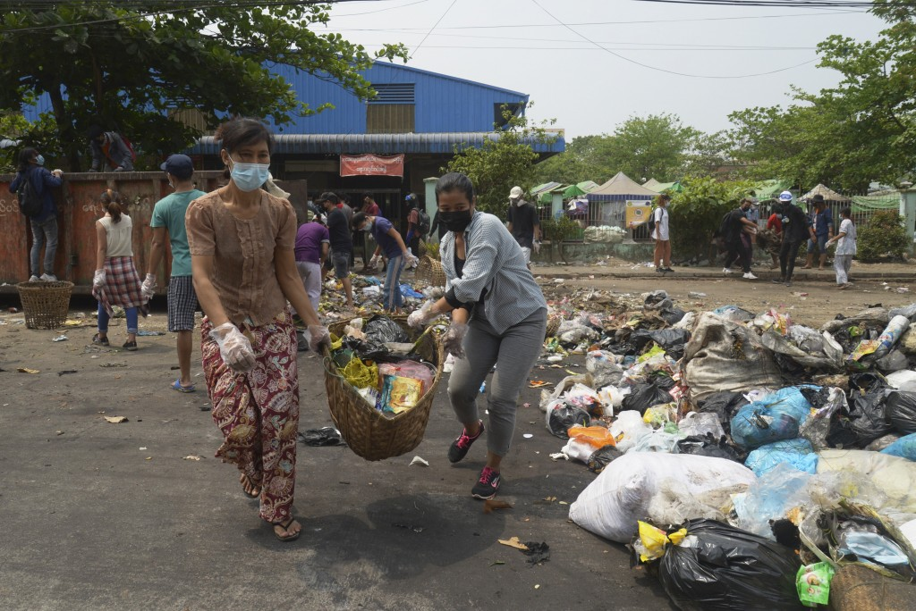 """Anti-coup protesters use garbage to block a road as a form of """"silent protest"""" in Yangon, Myanmar on Tuesday, March 30, 2021. At least 510 protesters ..."""