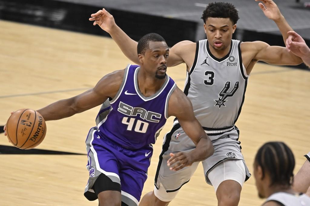 Sacramento Kings' Harrison Barnes (40) drives around San Antonio Spurs' Keldon Johnson during the second half of an NBA basketball game on Monday, Mar...
