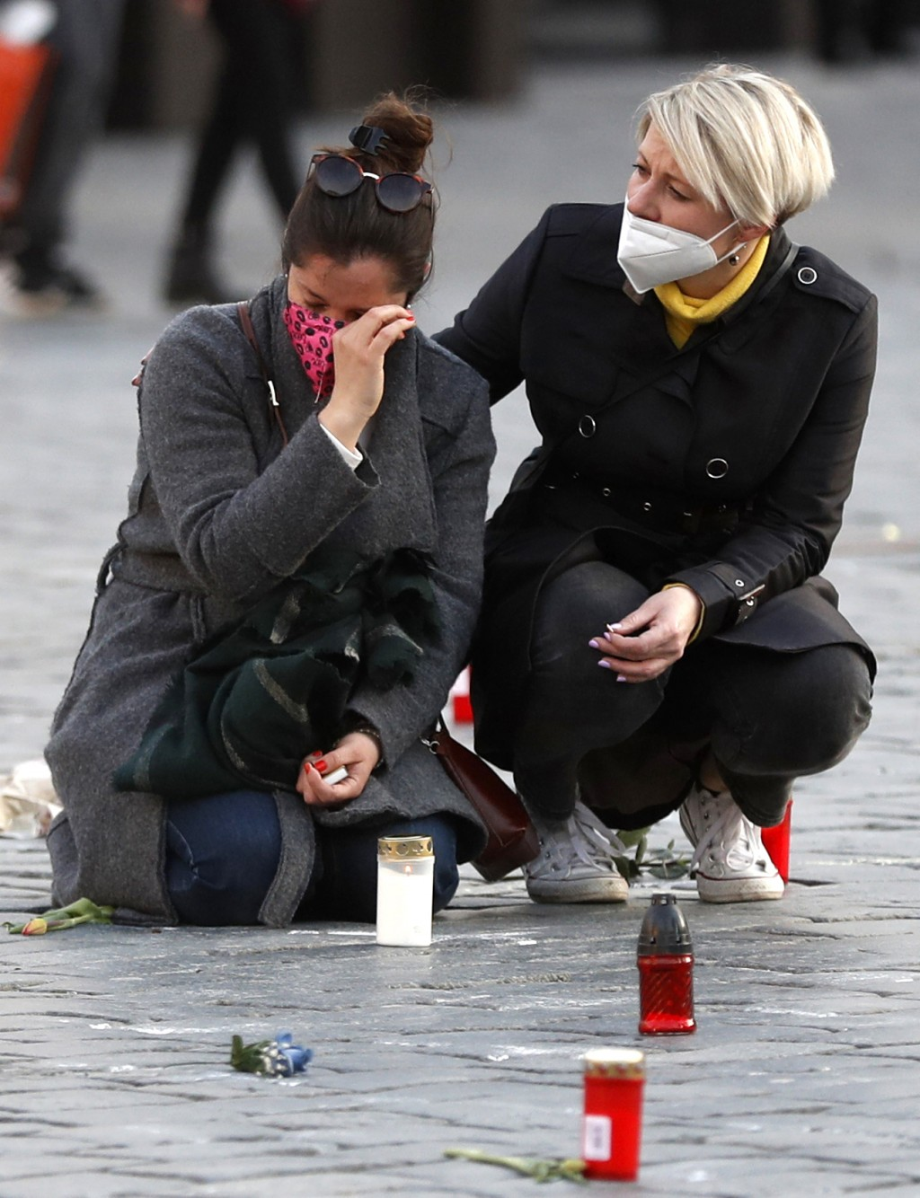 People pay respect to victims of COVID-19 at a spontaneous memorial place set at the Old Town Square in Prague, Czech Republic, Monday, March 29, 2021...