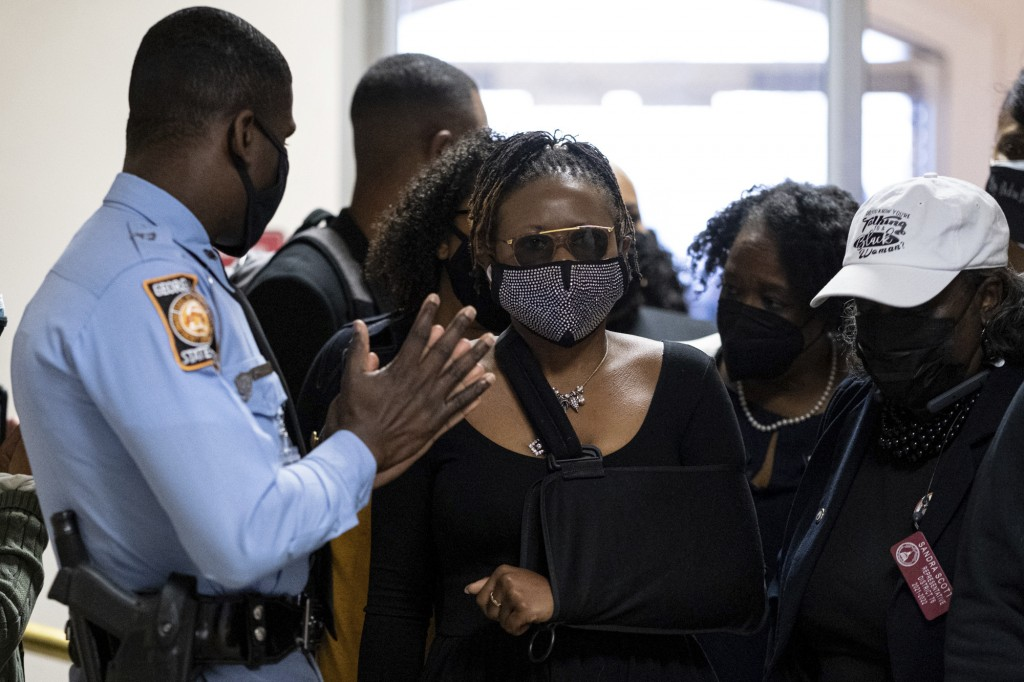 Georgia State Rep. Park Cannon, D-Atlanta, walks past a Georgia State Patrol officer as she returns to the State Capitol in Atlanta on Monday morning,...
