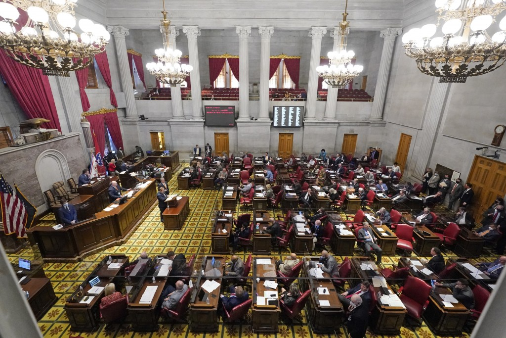 Members of the Tennessee House debate a bill allowing most adults to carry handguns without obtaining a permit Monday, March 29, 2021, in Nashville, T...