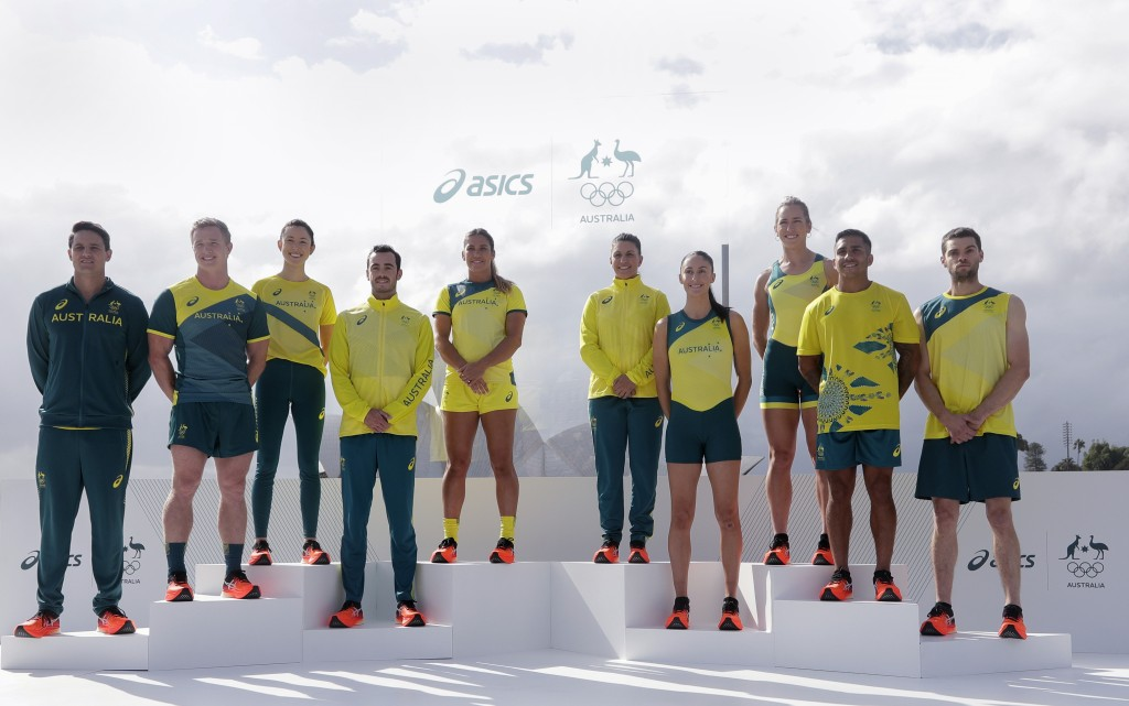 Olympic hopefuls pose for photos in their green and gold competition kits in Sydney, Australia, Wednesday, March 31, 2021, during the unveiling of the...