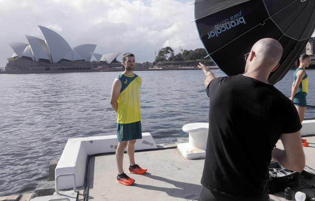 Tom O'Halloran poses for a photographer after Olympic hopefuls were presented their green and gold competition kits in Sydney Wednesday, March 31, 202...