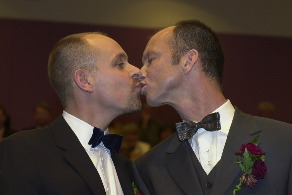 Gert Kasteel, left, and Dolf Pasker kiss after exchanging vows at Amsterdam's City Hall early Sunday, April 1, 2001. The pair was among four couples t...