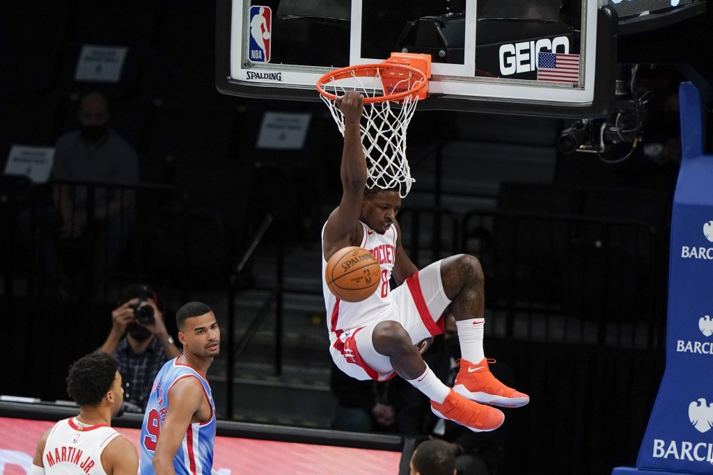 Houston Rockets' Jae'Sean Tate (8) dunks in front of Brooklyn Nets' Timothe Luwawu-Cabarrot (9) during the first half of an NBA basketball game Wednes...