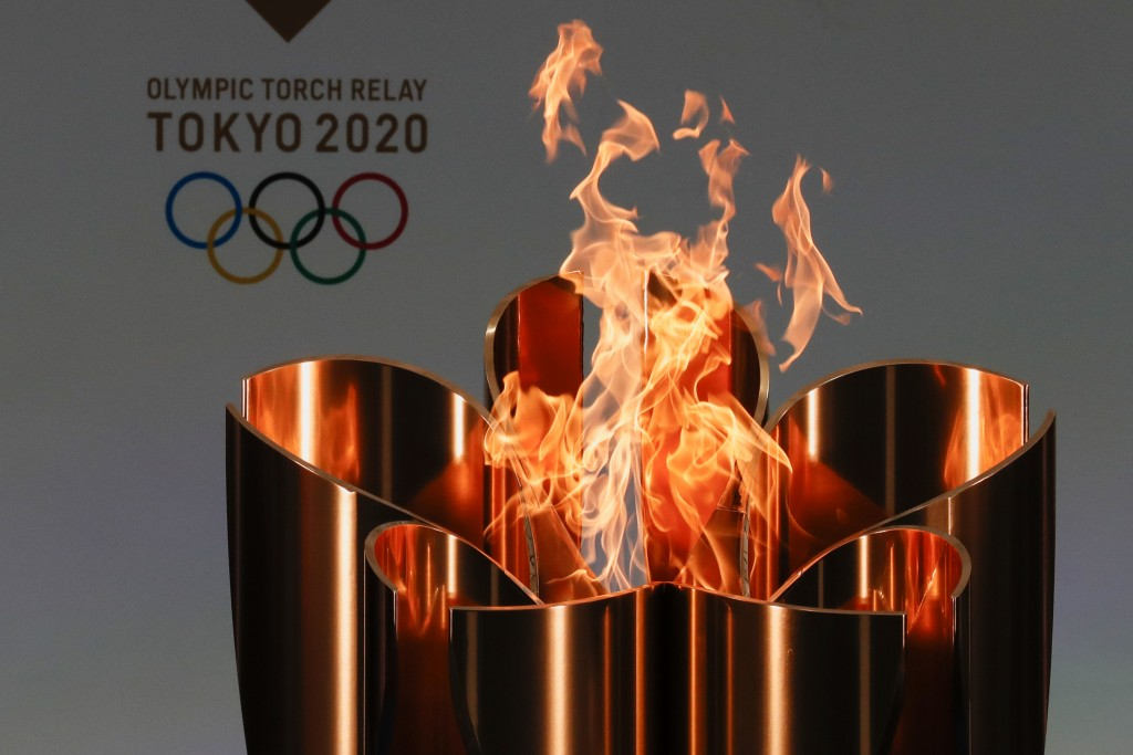 FILE - In this March 25, 2021, file photo, the celebration cauldron is seen lit on the first day of the Tokyo 2020 Olympic torch relay in Naraha, Fuku...