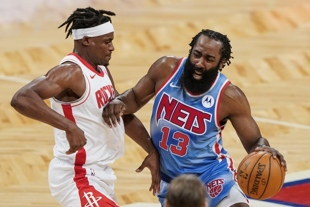 Houston Rockets' Danuel House Jr., left, defends against Brooklyn Nets' James Harden during the first half of an NBA basketball game Wednesday, March ...