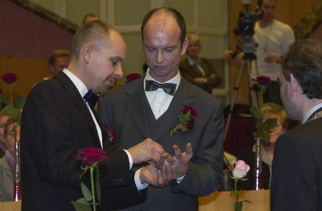 Gert Kasteel, left, and Dolf Pasker, right, exchange rings during a wedding ceremony at Amsterdam's City Hall early Sunday, April 1, 2001. The pair wa...