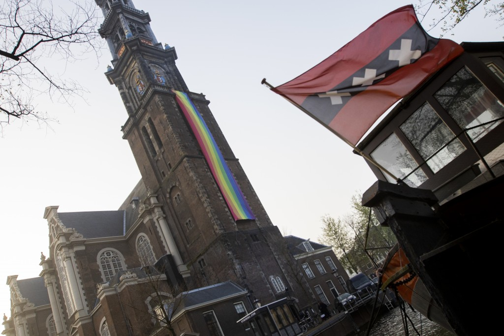 A large rainbow flag flies from the bell tower of Wester Church to mark the 20th anniversary of the first legalized same-sex marriage in Amsterdam, Ne...