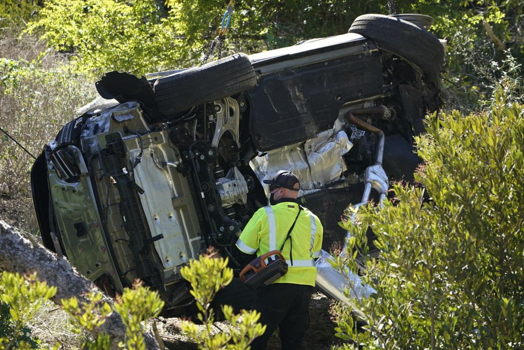 FILE - In this Feb. 23, 2021, file photo a vehicle rests on its side after a rollover accident involving golfer Tiger Woods, in Rancho Palos Verdes, C...
