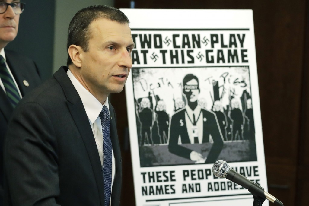 FILE - In this Feb. 26, 2020, file photo, Raymond Duda, FBI Special Agent in Charge in Seattle, speaks as he stands next to a poster that was mailed e...