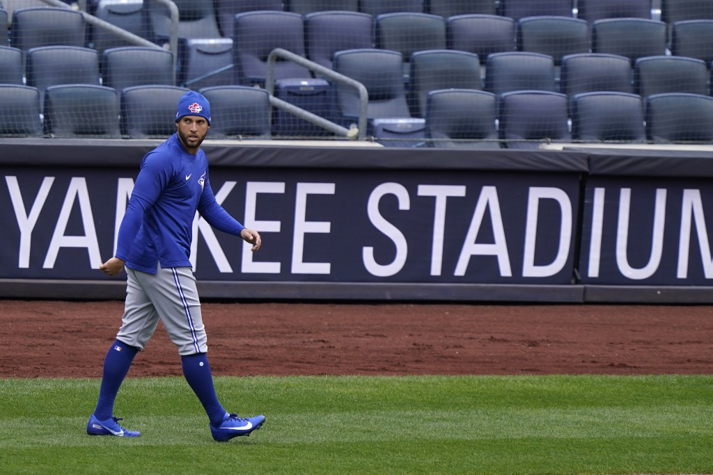 Toronto Blue Jays center fielder George Springer (4) walks on the field during a team workout, Wednesday, March 31, 2021, at Yankee Stadium in New Yor...