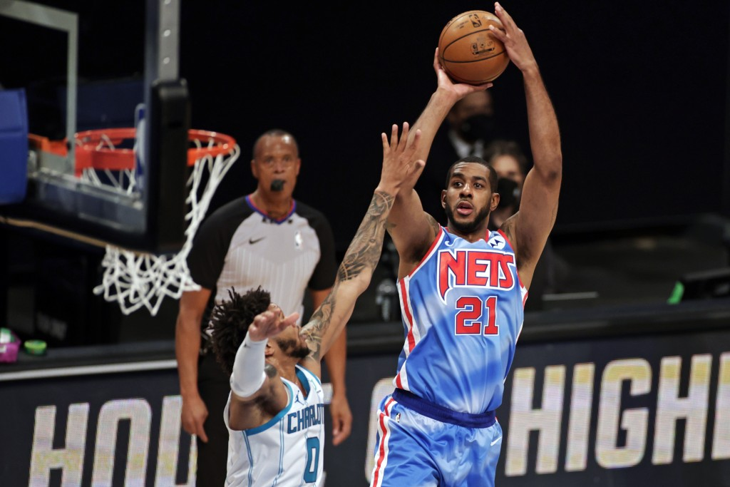 Brooklyn Nets center LaMarcus Aldridge shoots over Charlotte Hornets forward Miles Bridges during the first half of an NBA basketball game Thursday, A...