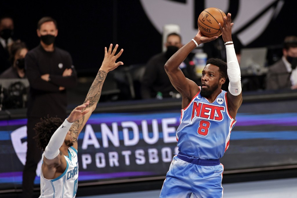 Brooklyn Nets forward Jeff Green shoots over Charlotte Hornets forward Miles Bridges during the first half of an NBA basketball game Thursday, April 1...