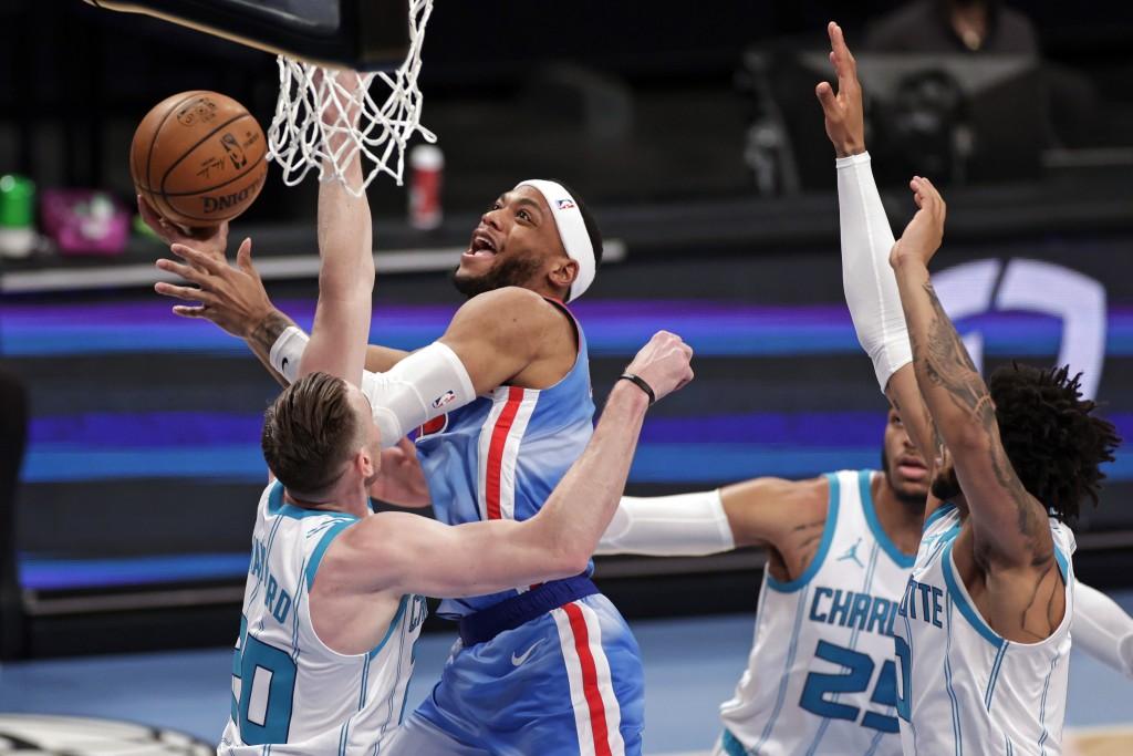 Brooklyn Nets forward Bruce Brown drives to the basket against Charlotte Hornets forward Gordon Hayward (20) during the first half of an NBA basketbal...