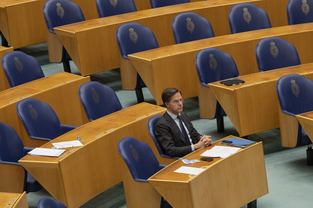Caretaker Dutch Prime Minister Mark Rutte listens to the debate in parliament in The Hague, Netherlands, Thursday, April 1, 2021. Rutte was fighting f...