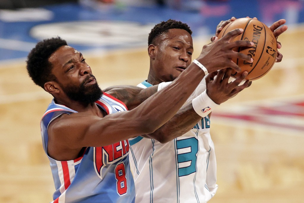 Brooklyn Nets forward Jeff Green (8) and Charlotte Hornets guard Terry Rozier reach for the ball during the first half of an NBA basketball game Thurs...