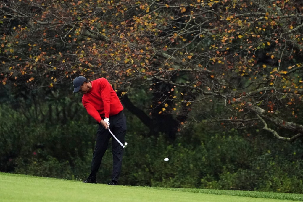 FILE - Tiger Woods hits on the second fairway during the final round of the Masters golf tournament in Augusta, Ga., in this Sunday, Nov. 15, 2020, fi...